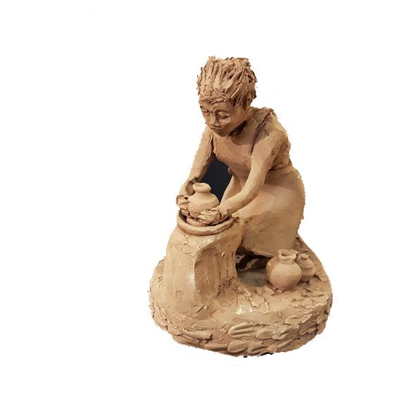 Sculpture céramiste au tour
